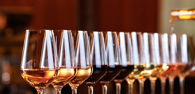 Wine glasses filled with different varietals